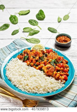 Chicken And Chickpea Curry Served With Jasmine Rice With Cherry Tomatoes, Baby Spinach, Yellow Curry