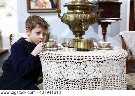 Child Drinks Tea From Samovar