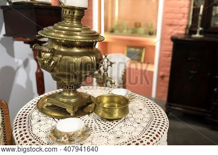 Copper Samovar On Round Table