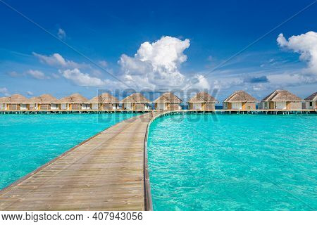 Beautiful Jetty Over Ocean Lagoon Beach In Maldives. Luxurious Over Water Villas On Tropical Island