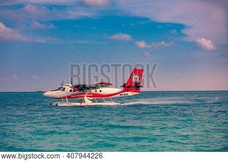 November.24.2019 - Ari Atoll, Maldives: Exotic Scene With Seaplane On Maldives Sea. Amazing Travel B
