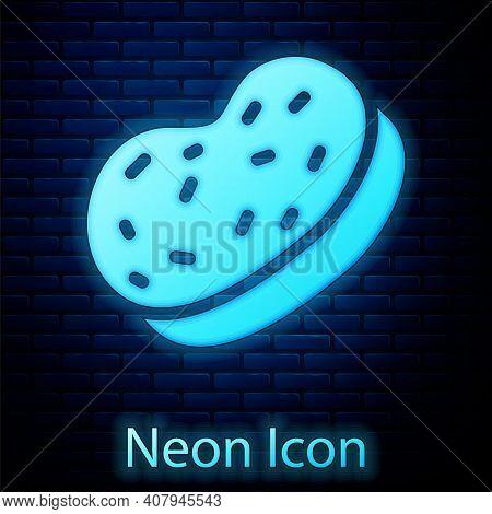 Glowing Neon Bath Sponge Icon Isolated On Brick Wall Background. Sauna Sponge. Vector