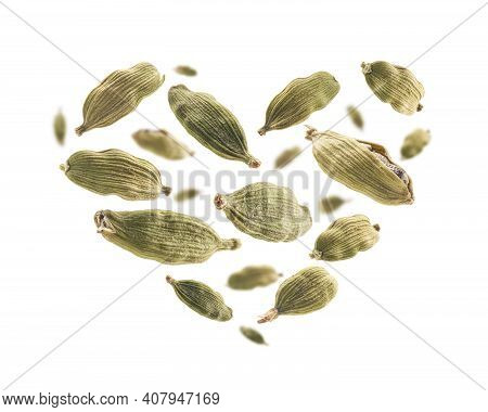 Cardamom Pods In The Shape Of A Heart On A White Background
