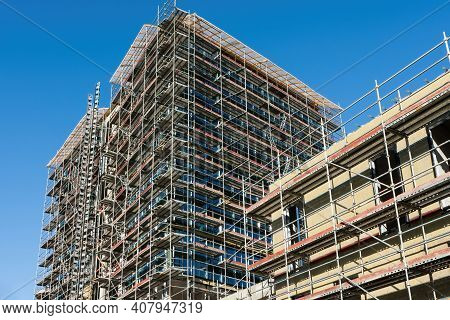 Building Under Construction With Scaffolds.scaffolding Steel Frames Installation At Construction Sit