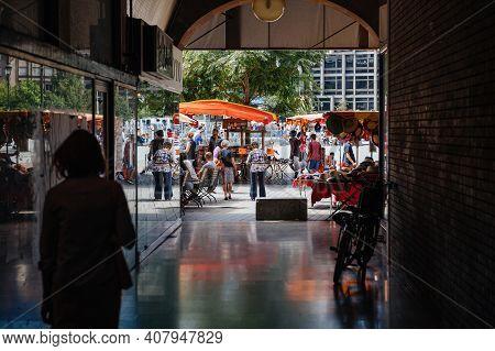 Strasbourg, France - July 29, 2017: People Walking Via Tunnel Toward Market Stall In Central Strasbo