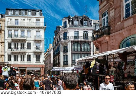 Strasbourg, France - July 29, 2017: Rear View Of Hundreds Of People Walking On The Street Of Strasbo