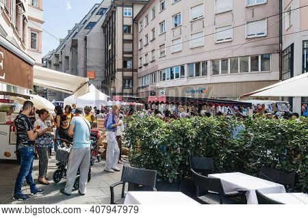 Strasbourg, France - July 29, 2017: Large Crowd Of People Walking Near Homme De Fer Tramway Station