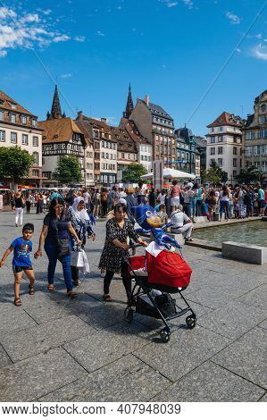 Strasbourg, France - July 29, 2017: Failies, Locals And Visitors People Pedestrians Walking In Centr