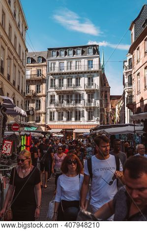 Strasbourg, France - July 29, 2017: Hundreds Of People Near Market Stall With Sellers And Customers