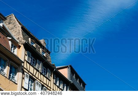 Low Angle View Of French Alsatian Timbered House Architecture With Clear Blue Sky In Between Them