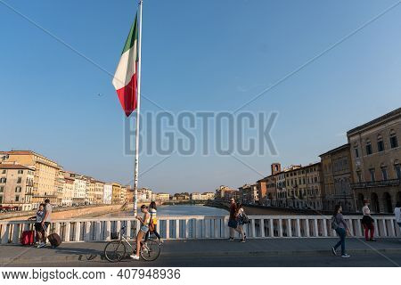 Pisa, Italy-october 21, 2018:view Of The Arno River Tha Crosses Pisa During A Sunset