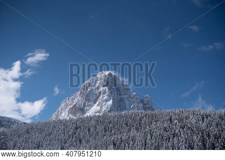 Wide Angle Views Of Sassolungo In Spring, Covered In Snow. Sunny Day In The Dolomites, Val Gardena.