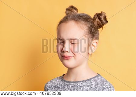 Cute Charming Funny Caucasian Blonde Girl Stands With Closed Eyes In Anticipation Of A Surprise. Chi