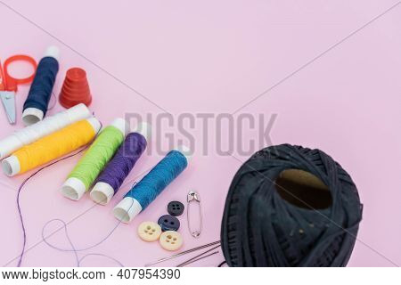 Sewing Background. Accessories For Needlework On Wooden Background. Spools Of Thread, Scissors, Butt