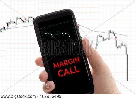 Hand Holding A Smartphone With The Message Margin Call. Trading Loss Stock Exchange. Brokerage Accou