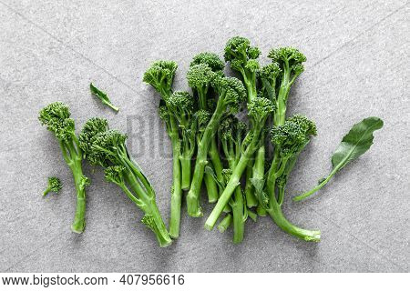 Broccolini. Fresh Bunch Of Broccoli Sprouts On A Cooking Table. Healthy Food Concept. Top View