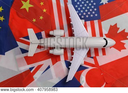 Avia Travel Theme. The Figure Of A Passenger Plane On The Background Of Many Flags Of Countries