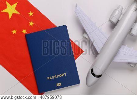 Travel Concept. Passenger Plane, Passport And China Flag On White Background