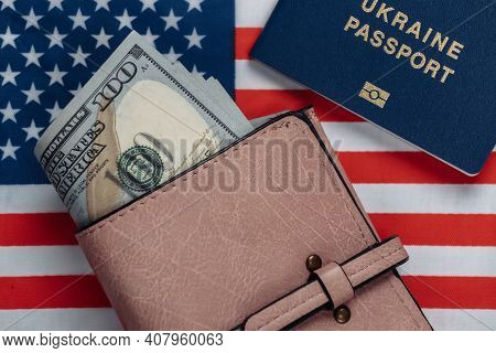 Leather Wallet With Hundred Dollar Bills, Passport On The Background Of The Usa Flag. Travel Or Emig