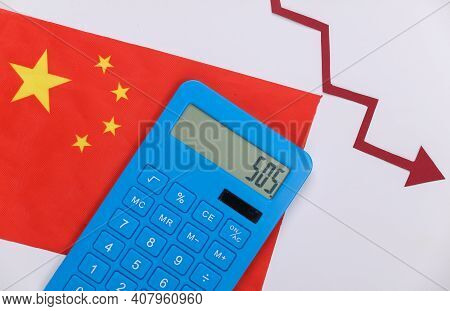 China Flag With Red Fall Arrow And Calculator. Fall Graph Going Down. Economic Recession, Crisis
