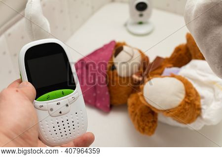 Picture Of A Baby Monitor, Camera And A Teddy Bear In  Child Room