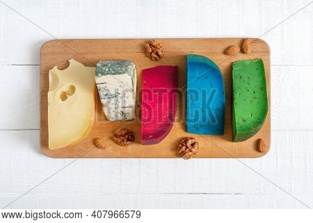 Assortment Of Different Sorts Craft Cheese. Cheeseboard On A White Wooden Background. Top View.