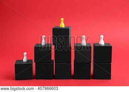 Black Blocks With Playing Pieces On Red Background. Roles And Responsibility Concept