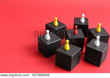 Black Blocks With Playing Pieces On Red Background, Space For Text. Roles And Responsibility Concept