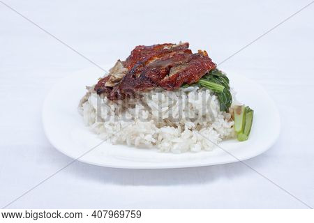 Rice With Roast Duck On Top In A White Plate At The Restaurant.