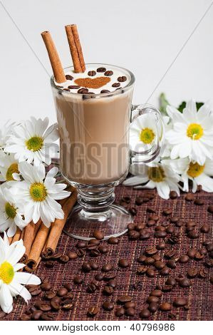 Cup of Cappuccino with ?innamon and White Flowers