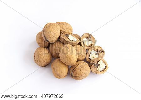 Walnuts In A Shell On A White Background. Healthy Nuts.