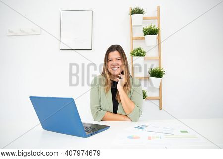Young Enterprising Businesswoman Working In Her Office