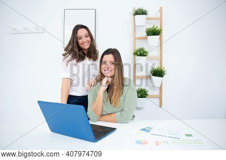 Young Enterprising Businesswomen Working In Their Office