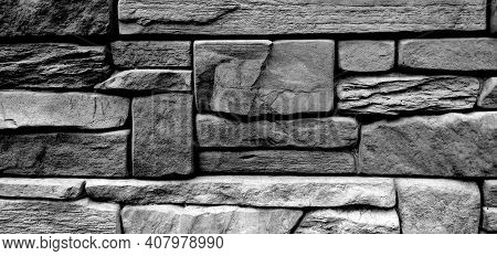 Figure Of A Stone Wall. Texture Of Gray Stone Wall Shape Background. The Wall Is Made Of Various Rec