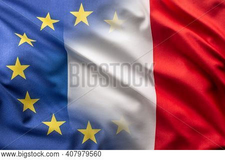 Flags Of France And Eu Blowing In The Wind.