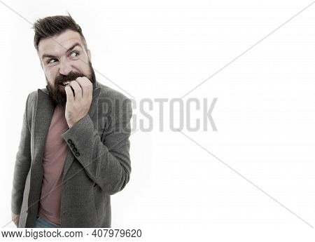 Man Bearded Hipster Doubtful Face Bites Finger While Thinking. Nervous Make Decision. Hipster Brutal