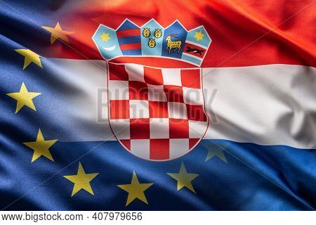 Flags Of Croatia And Eu Blowing In The Wind.
