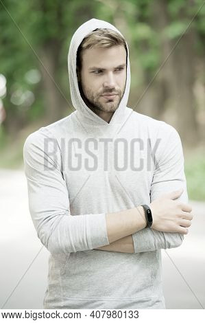 Seriousness And Masculinity. Sportswear Fashion. Sportsman Relax After Training Outdoor. Handsome Un