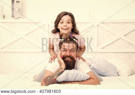 Family Bonds. Spending Time Together At Home. Little Girl Made Funny Hairstyle For Daddy. Daughter A