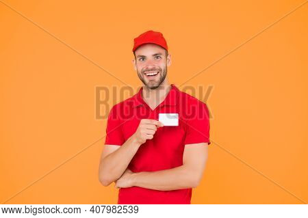 Happy To Serve. Man Red Cap Yellow Background. Delivering Purchase. Delivered To Your Destination. S
