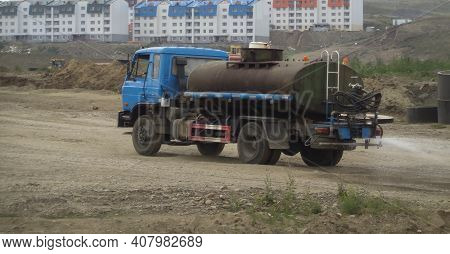 Kazakhstan, Ust-kamenogorsk, 21 July 2020: Water Truck Spraying Water On The Road To Keep Dust Out.
