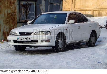 Kazakhstan, Ust-kamenogorsk, January 11, 2020: Toyota Vista. Old Japanese Car. White Sedan