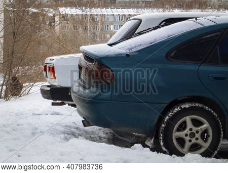 Kazakhstan, Ust-kamenogorsk, January 28, 2020: Two Cars Parked. Back View. Winter Snow. Mazda And La