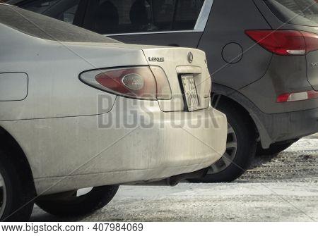 Kazakhstan, Ust-kamenogorsk, February 6, 2020: Two Cars Parked. Back View. Winter Snow. Lexus And Ki