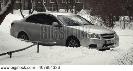 Kazakhstan, Ust-kamenogorsk,  February 7, 2020: Chevrolet Epica. Gray Car. Winter Snow