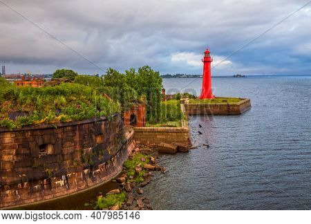Lighthouse Of Fort Kronshlot. Fort Kronshlot In The Gulf Of Finland Of The Baltic Sea Built In 1704.
