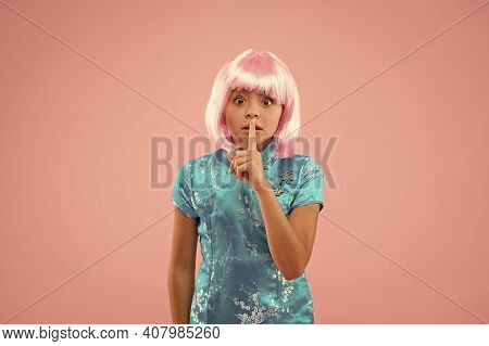 Keep A Secret. Small Chinese Girl In Pink Wig. Small Child With Fashion Look. Kid In Traditional Chi