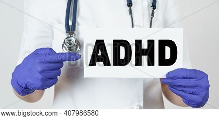 Medicine And Health Concept. The Doctor Points His Finger At A Sign That Says - Adhd. Attention Defi