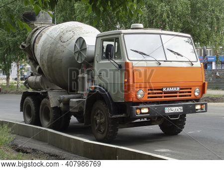 Kazakhstan, Ust-kamenogorsk, May 21, 2020: Old Vintage Soviet Truck Kamaz. Cement, Concrete Mixer Tr