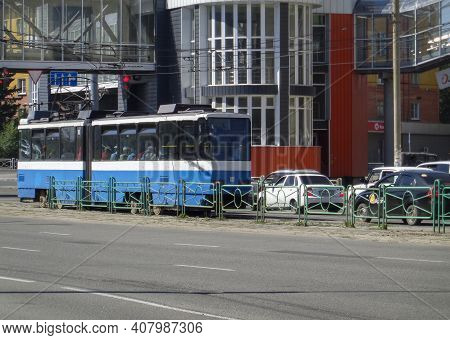 Kazakhstan, Ust-kamenogorsk, June 12, 2020: Traffic. One Of The City Streets. Cars, Tram, People. Ci